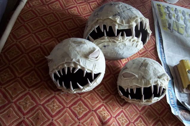 human fly trap, made out of paper mache, but can be cool kids clay project. cover a balloon with slip covered newpaper. Let dry to leather hard, pop balloon then cut your mouth opening. Sculpt eye openings with coils, add bisque pieces of porcelain. Will smoke during firing, ventulation a must. #kids project