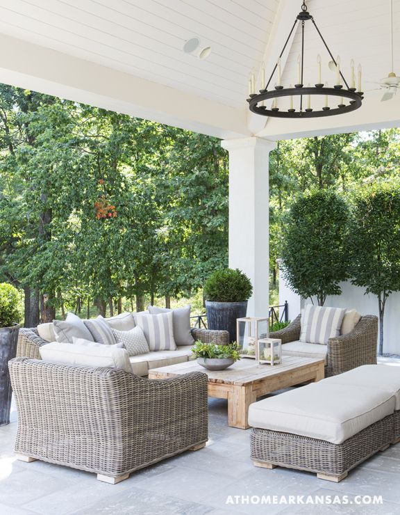 An arrangement of wicker furniture creates a cozy conversational area on the back patio.