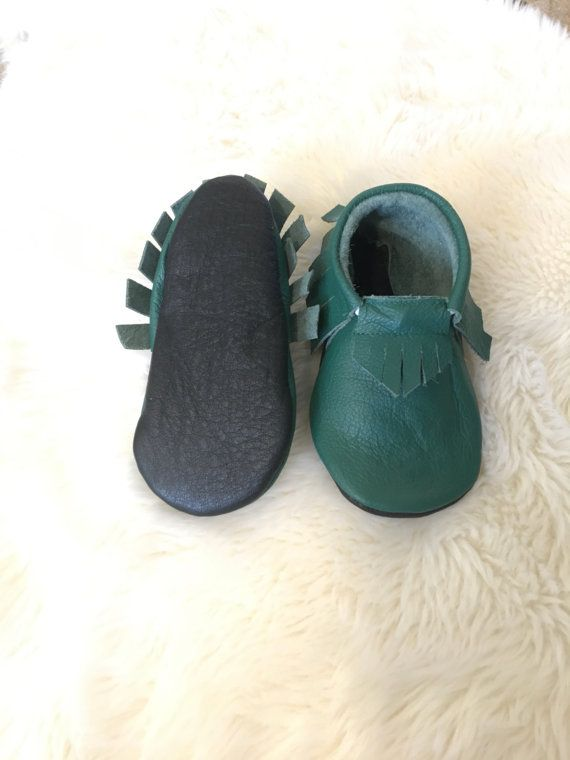 These baby and toddler moccasins are so soft and comfy inside for children. The green leather is a little thinner, but the super soft black sole is much thicker to protect those little feet! If you would like the sole of the shoe green, please mention in comments when you purchase or I will assume you want black. PLEASE if you can, measure your childs foot from heel to toe and leave about 1/4-1/2 of growing space. Sizes are listed in Months (which is not always the same for children...