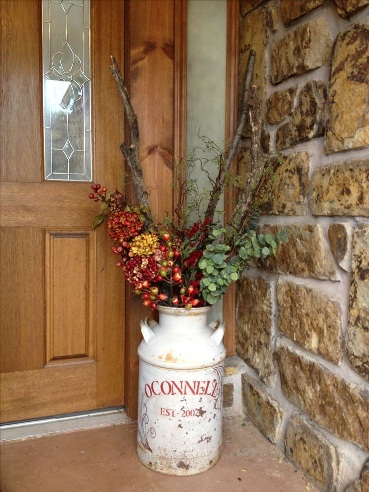 Paint your last name on an old milk jug and put it by the front door. Change decorations seasonally. I have an old milk jug that now has a new purpose!!!
