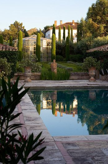 Clive Nichols, Provence - this photo perfectly illustrates what I was saying about paving being a better accompaniment to the swimming pool.