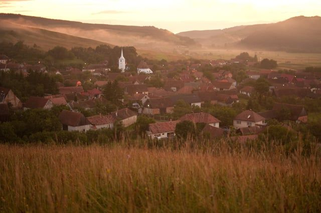 """The Clay Village of Transylvania is a story of a Hungarian Man named Mozes who lives in a little village called Agyagfalva (Lutita in Romanian). The name of the village in Hungarian is translated as """"The Clay Village"""", and it is a location full of photo and film opportunities. Directed by Mark Hemmings"""