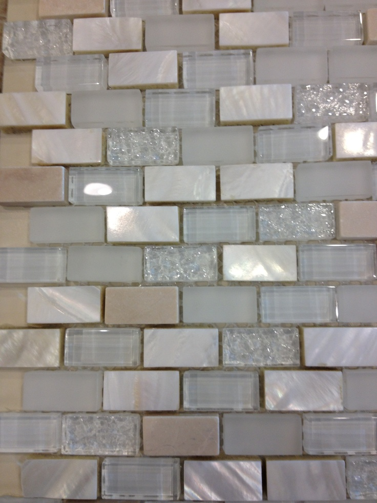 Tumbled travertine mother of pearl and glass tile looks better in person maybe for for Tumbled glass tile
