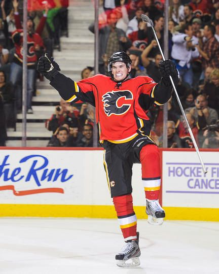 CALGARY, AB - OCTOBER 11: Sean Monahan #23 of the Calgary Flames celebrates after scoring the game-winning goal against the New Jersey Devils during an NHL game at Scotiabank Saddledome on October 11, 2013 in Calgary, Alberta, Canada. The Calgary Flames defeated the New Jersey Devils 3-2