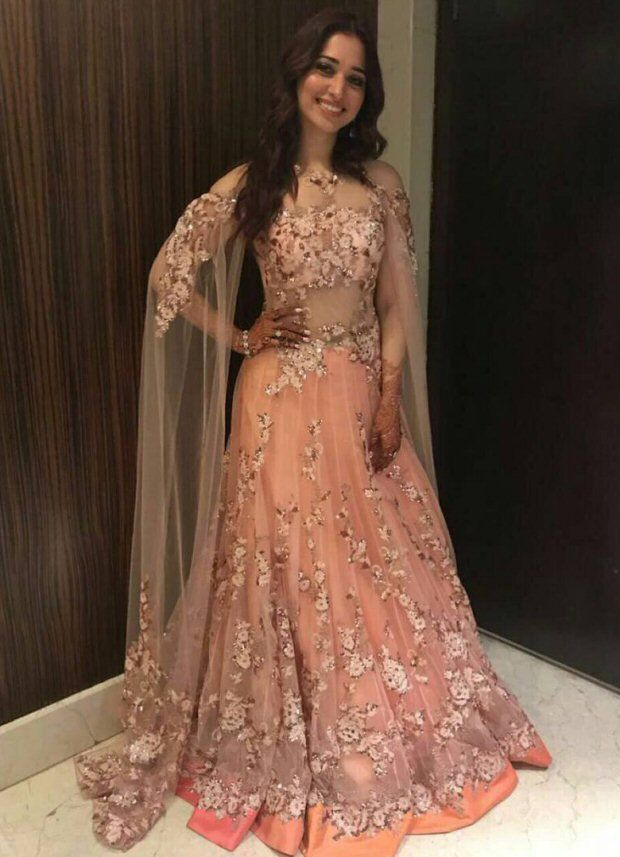 Tamannaah Bhatia at her brother's wedding in Mumbai flaunting pretty sister of the groom looks | Tamannaah Bhatia in a pretty pastel peach gown with flower work insulter by Neeta Lulla | sister of the bride looks| Peach Pink Gown| Indo-Western Peach Dress-Witty Vows shares things no one tells brides, covers real weddings, design trends and the right vendors, candid photographers etc. | Curated by #WittyVows - www.wittyvows.com"|620|857|?|c5fb0bcb3f2711582607dd11141b11c6|False|UNLIKELY|0.31844672560691833