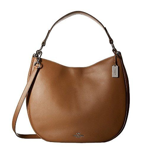New Trending Make Up Bags: COACH Womens Natural Calf Nomad Hobo SV/Saddle Hobo. COACH Women's Natural Calf Nomad Hobo SV/Saddle Hobo  Special Offer: $377.84  400 Reviews Made of leather. Magnetic snap closure. Lined with luxurious leather the interior features one zip pocket and two slip pockets.Made in USA or Imported