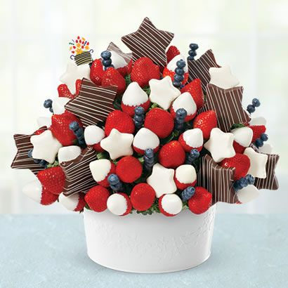 Our Patriotic Party will add fireworks to any celebration this summer! A WOW-worthy arrangement featuring pineapple stars, strawberries and blueberries for that perfect pop of red, white and blue. Surprise your friends, family and neighbors with this delicious choice for any summertime get-together! Available for a limited time only.