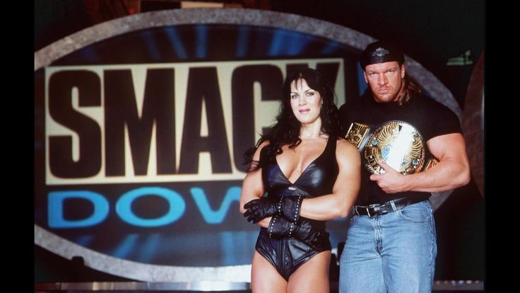 "Former pro wrestler Joanie ""Chyna"" Laurer, pictured here with Triple H in 1999, died April 20, 2016, KTLA reports. She was 45."
