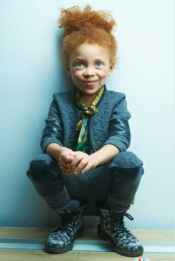 Mixed race child with ginger hair