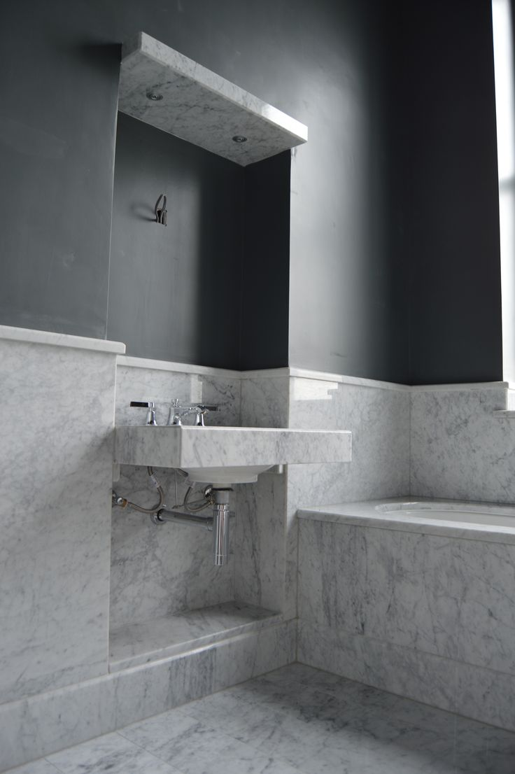 Bianco Carrara Wall, Floor & Bath Cladding with a box mitred sink and soffit