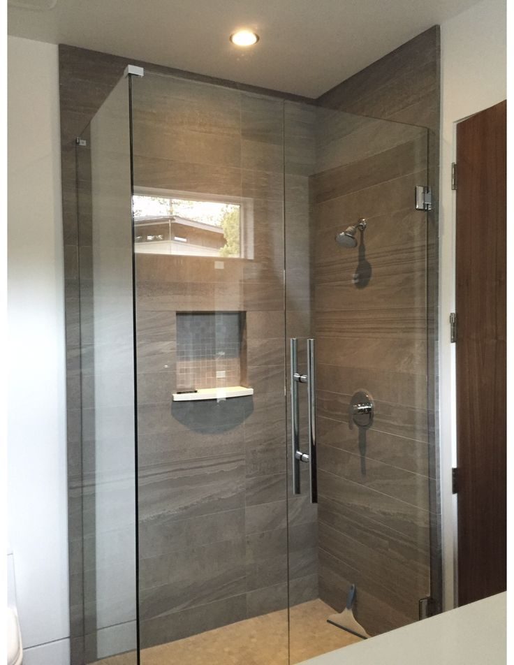 a 90degree frameless custom shower door is one of our most popular designs