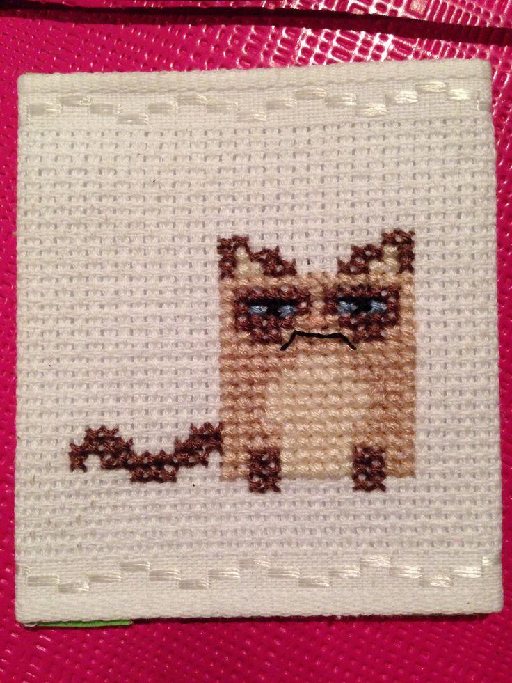 Grumpy cat cross stitch, finished as a cute fridge magnet