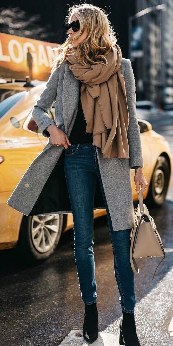 Amy Jackson + grey overcoat + beige blanket-style scarf + black top + boots + jeans + easy + achievable spring style   Brands not specified.