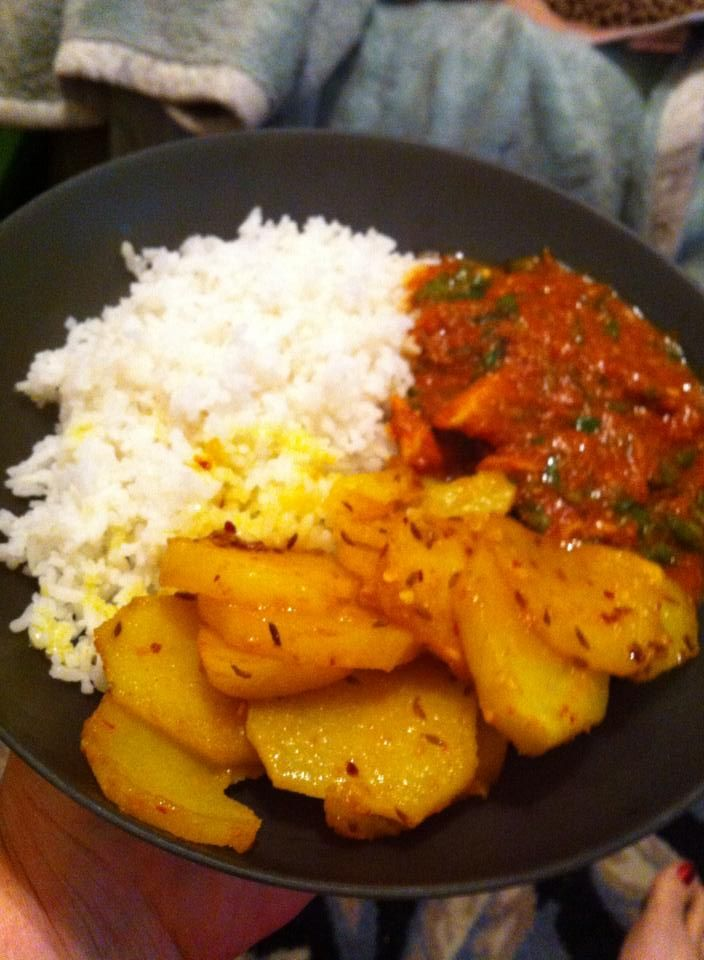 """Chicken Kadhi (pronounced """"car-hi"""") is a chicken dish cooked in a pan called a kadhi, which is the Indian version of a wok. Tomato-spicy goodness. I made it this day with Bombay potatoes-basically spiced fried potatoes."""