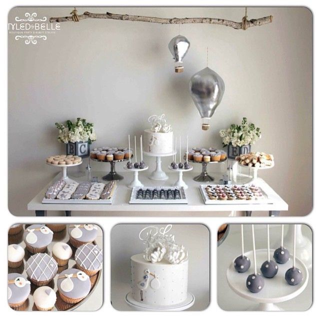Going w/ this theme--silver, dusty blues & whites w/ natural/wood accents, storks, hot air balloons