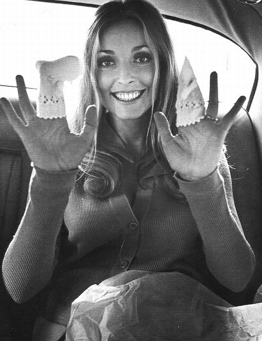 Sharon Tate ... this photo breaks my heart...Sharon is holding baby booties, she is pregnant. Shortly after this photo, Charles Manson went on his killing spree. 1969