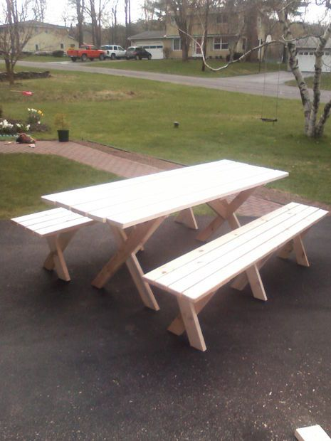 Build your own picnic table with unattached benches according to http://www.instructables.com/id/Picnic-table-with-detached-benches/