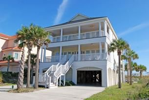 Two levels of living space are perched atop stilts at this North Myrtle Beach house and a private boardwalk to the beach extends from the middle level. On the ground level of this North Myrtle Beach house rental is a sparkling blue swimming pool and a hot tub. Seven bedrooms and six-and-one-half baths. Up to 27 people are accommodated in this North Myrtle Beach vacation rental.