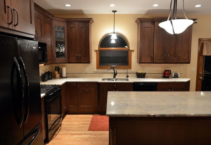 dark brown kitchen cabinets with black appliances impressive kitchen design using ivory gold granite for 575