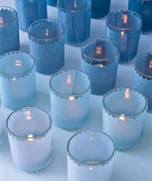 Wrap votives in different shades of the same color to create an ombre arrangement