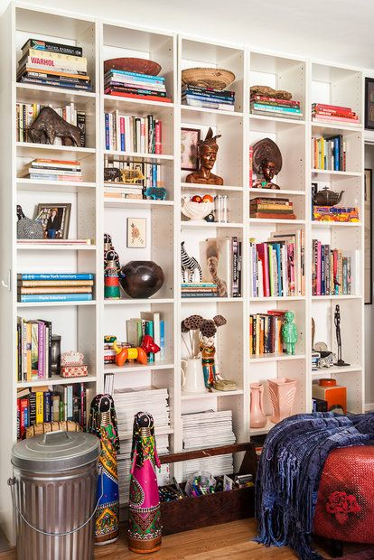 """The Ikea shelves in the living room are filled with books and objects from Smail's travels. """"I knew that I needed bookshelves,"""" Smail said..."""