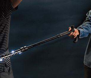 """Self Defense Stun Cane - Stun Cane features an adjustable walking cane, Ultra-bright LED flashlight and a stun gun with an unheard of 1-million volt charge that will knock down any attacker! Weight capacity of 250 lbs and is adjustable from 32″"""" to 36″"""