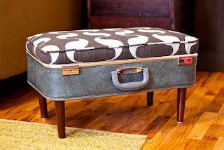 Old Refurbished Suitcase...as an ottoman...pick it up & take whenever you need an extra seat.