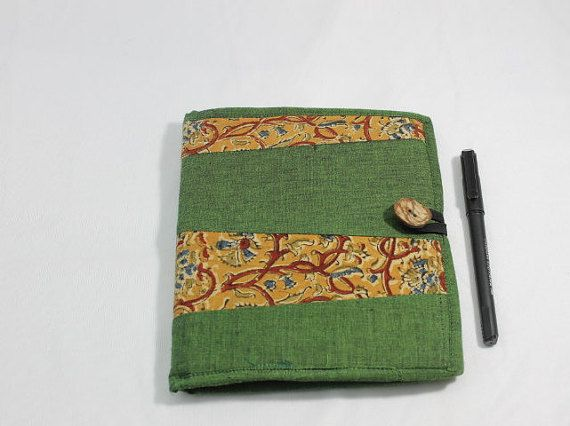Covered in green cotton and mustard kalamkari, this diary also has a pocket and a handstitched bookmark with a tassel inside