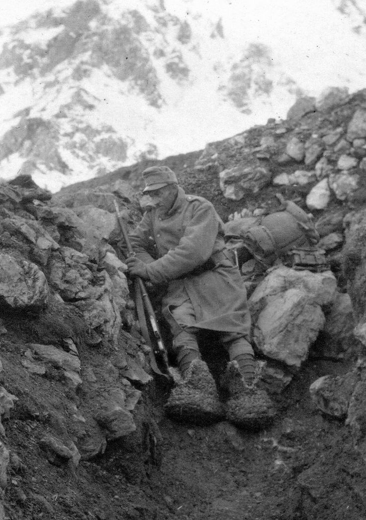 An Austro-Hungarian soldier on the Isonzo front, wearing straw shoes to protect his feet from the cold, c1916.