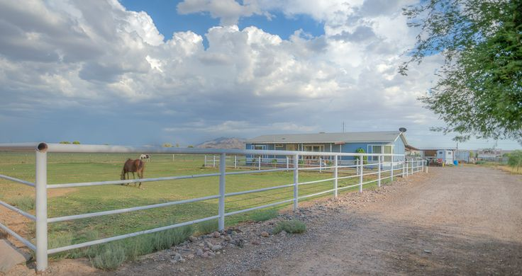 SOLD! Horse Property 16811 W PIONEER ST, Goodyear, AZ 85338 - Irrigated (hard to find!) on over an acre of land with unobstructed mountain views and still within minutes of shopping, freeways, and more! Manufactured home, 5 completed horse stalls, 2 car garage, 3+ car paved and covered patio, and lots of extra storage. #amyjonesgroup