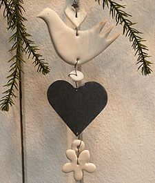 Stacked dove ornament - inspiration - clay dove, wooden / tin heart (shabby chic: distress or crackle white heart, paint on word, small flower, crystal drop) (rustic/prim distress heart, maybe pierce edges and blanket stitch or cover with homespun, buttons for spacers) - very versatile in styling!  ************************************************   Grand Illusions - #handmade #Christmas #ornament #dove #heart #stacked - #shabby #chic #rustic - tå√