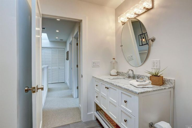 Traditional Powder Room with Quatra 4 Light Bath Bar, Ultra Widespread Bathroom Faucet, Cafe Frameless Large Round Mirror