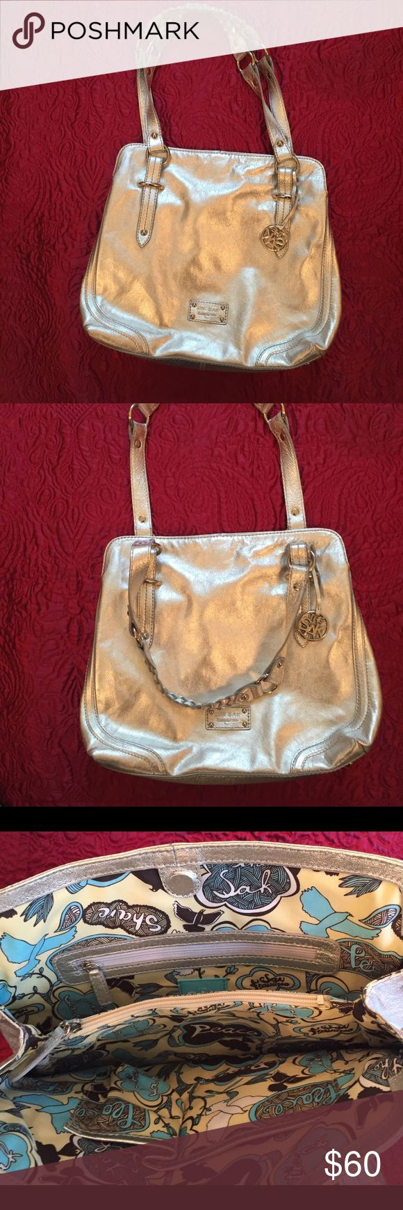 Silver Handbag Silver Handbag By The Sak NWOT Leather w/ Polyester Interior. Front wall 2 side pockets. Middle zipped compartment. Back wall zipper pocket. Main snap magnet closure. Silver toned hardware. The Sak Bags Shoulder Bags