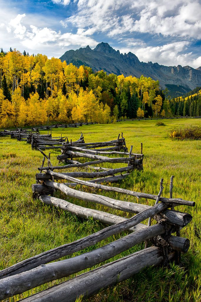 ***Log fence and autumn colours (Colorado) by Nasim Mansurov