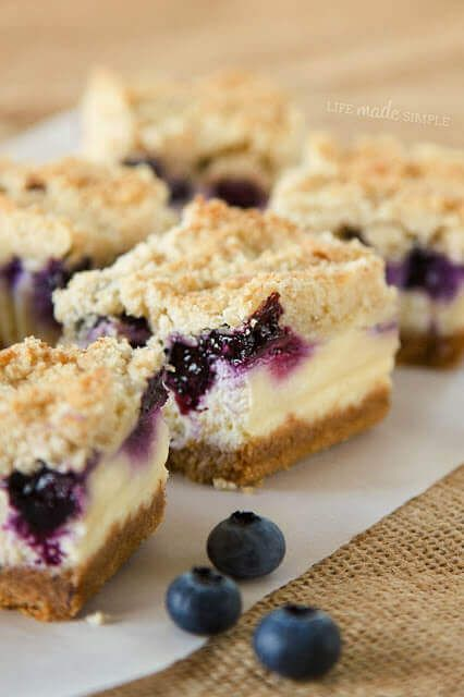 Blueberry Crumble Cheesecake Bars have a graham cracker crust, smooth vanilla cheesecake, delicious blueberries and buttery crumble.  via @bestblogrecipes