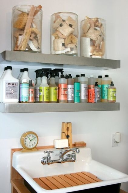 The laundry room side. SHELVES!!!! and --- Mrs. Meyers cleaning supplies. These products' clever graphic design is the best thing to happen to laundry room staging since those Borax boxes worshipped by Warhol.