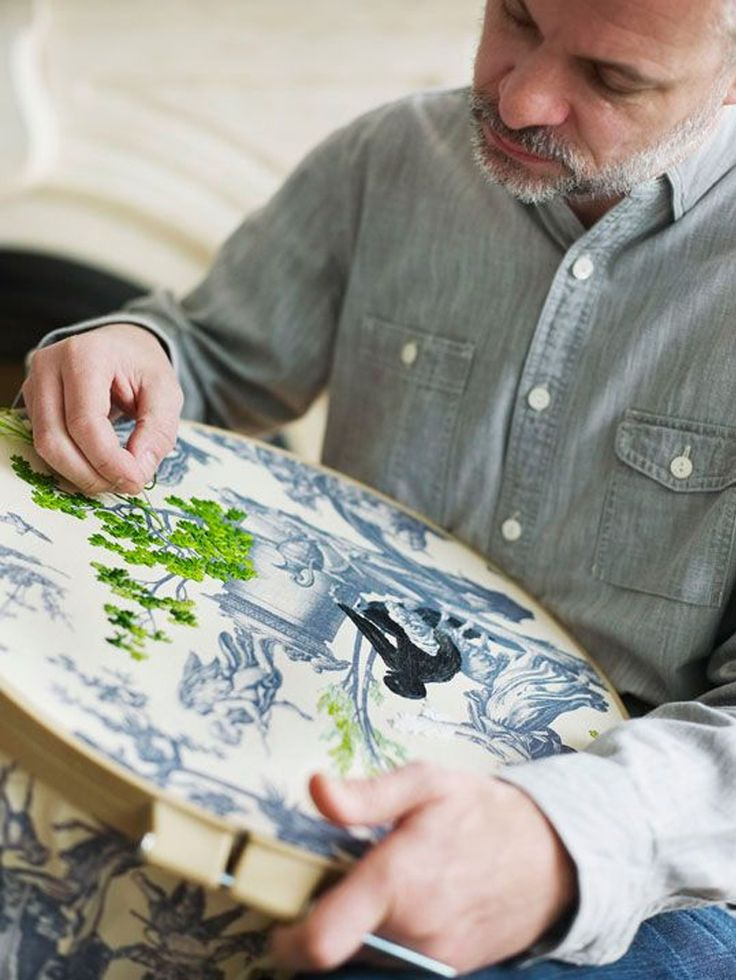 richard saja embroidering on top of a toile de jouy print