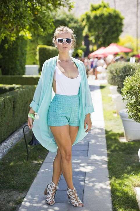 Natalia Perzyna paired her white one-piece with these cute textured turquoise shorts and a kimono top. One of my favorite Coachella looks.