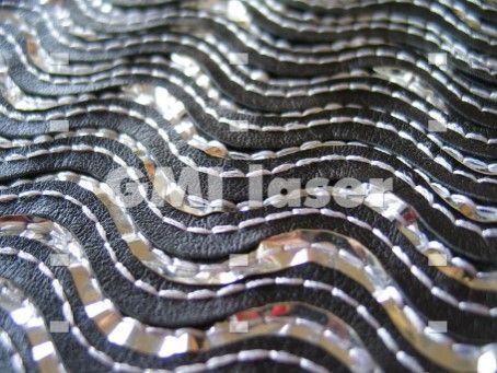 #lasercutgarment Laser cut garment made with GMI laser bridge cutting machine