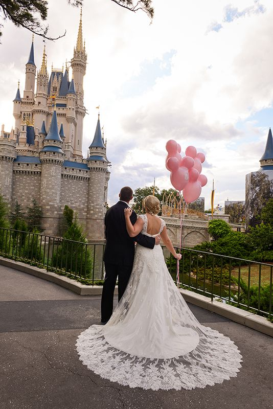 Mickey Mouse balloons are the perfect accessory for a portrait session in Disney's Magic Kingdom