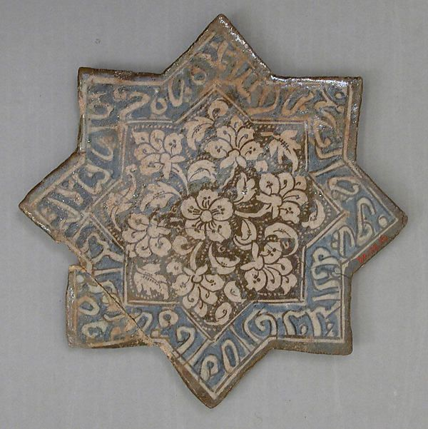 Star-Shaped Tile Object Name: Star-shaped tile Date: first half 14th century Geography: Iran, Varamin Culture: Islamic Medium: Stonepaste; overglaze luster-painted Dimensions: 8.25 in. wide (21 cm wide) Classification: Ceramics-Tiles Credit Line: The Grinnell Collection, Bequest of William Milne Grinnell, 1920 Accession Number: 20.120.50