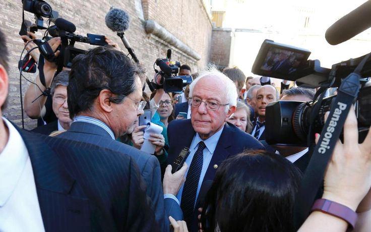 Bernie Sanders took a private jet to the Vatican to address a conference on wealth inequality on Friday, hours after attacking Hillary Clinton over her stance on fossil fuels.