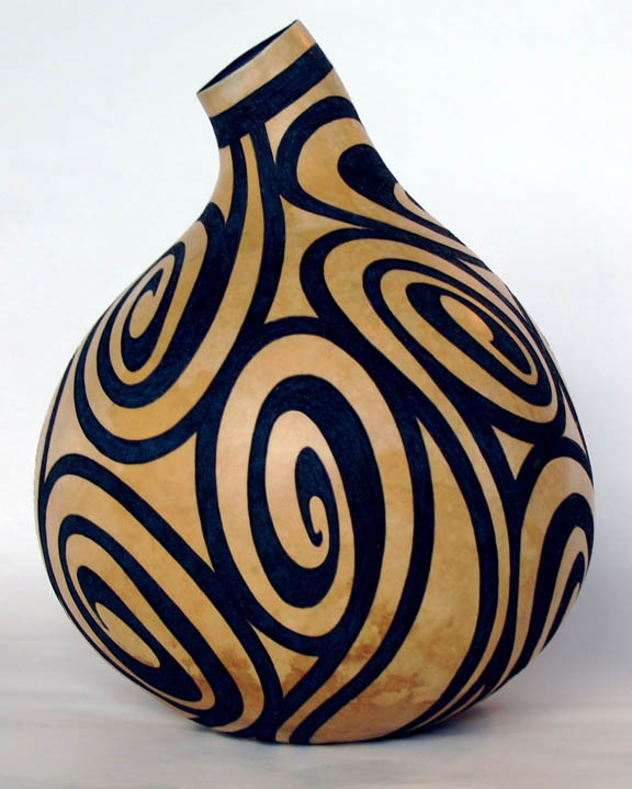 Karen Cheeseman...technically not wood, but it is a cellulose material that hardens and looks very much like wood
