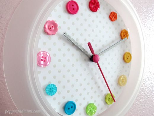 Rainbow Button IKEA Clock Hack - So cute! Replace clock face with a circle of scrapbook paper or other paper with a background you like, place buttons where numbers would be, cover clock hands with washi tape. Simple!