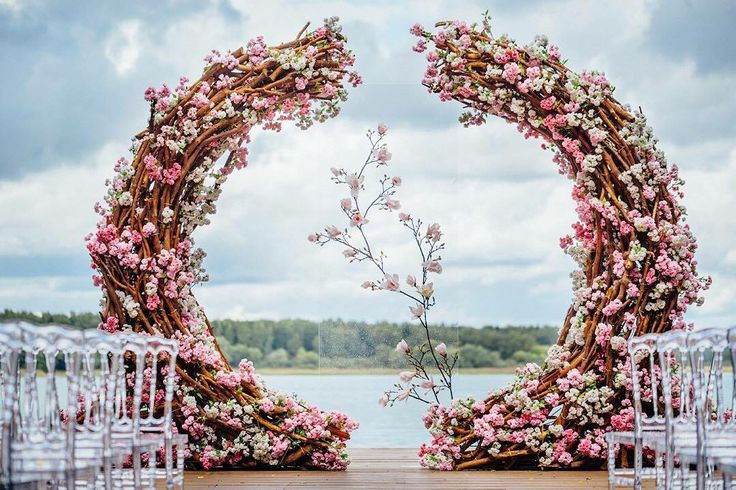 Gorgeous floral outdoor wedding ceremony arch