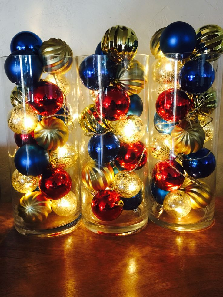 Create a dramatic glowing holiday centerpiece with a glass cylinder vase, round…