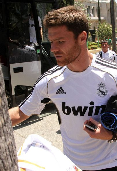 Xabi Alonso Photos Photos - Cristiano Ronaldo and teammate Xabi Alonso greet some of their fans as they return to their hotel from the Real Madrid practice. - Cristiano Ronaldo Leaves Practice in LA