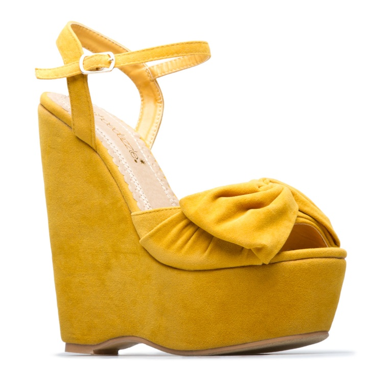 So girly.  Oversized bow platform wedges in one of my favorite colors,  mustard yellow.