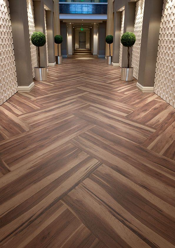 Hotel Corridor Featuring Affinity255 Smoked Walnut Vinyl Flooring In Herringbone Pattern