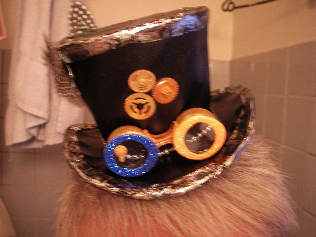 little steampunk hat i made out of recycled bits and parts . paintet and punked up
